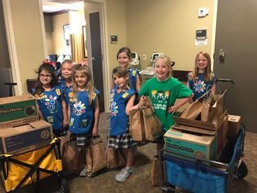 Several members of the St. Jude Catholic School's first-grade Girl Scout Troop 10133 deliver cookies and activity kits for children at the Baton Rouge General Regional Burn Center. Pictured are: Adele Crasto; Ainsley Crochet; Camille Hamner; Anna Katherine Dixon; Ella Claire Mouledous; Camille Mendler; and Emily Vercher.
