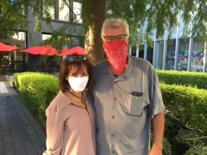man and woman wearing masks